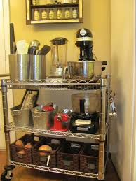 use an industrial metal cart from sams club as a storage cart for kitchen appliances and