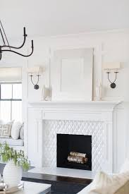 silver leaf frame over white wood fireplace mantel