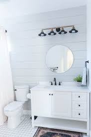 grey and white bathroom renovation with hex tile and shiplap 34