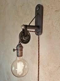 plug in industrial lighting. Industrial Pulley Sconce Lamp. Plug In. By IroncladIndustrial In Lighting