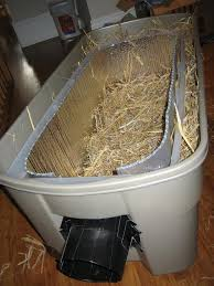 step 13 14 make thick straw bed in interior bin stuff straw down the sides back and front for insulation