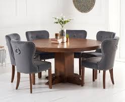 torino 150cm dark solid oak round pedestal dining table with knightsbridge velvet dark oak leg chairs