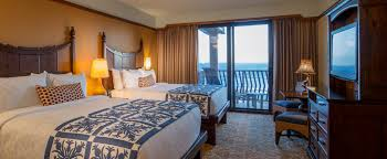 ... Aulani Terry A King Bed Opposite A Dresser With Flat Panel TV And A  Table And Chair