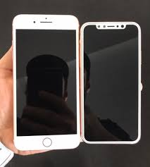iphone 8 gold. we also get to see the dummy unit put up against a current iphone 7 plus, where lack of bezels really stands out. iphone 8 gold