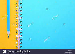 Blue Pencil On Notebook With Colored Blank Pages Stock Photo
