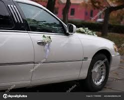 wedding car decoration for the bride and groom on the car door stock photo
