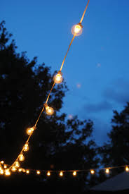 Fishing String Lights How To Hang Outdoor String Lights The Deck Diaries Part 3