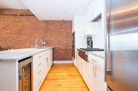 contemporary kitchen with brick veneer wall
