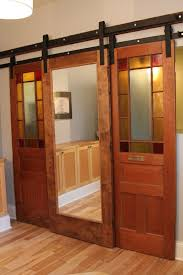 enchanting half glass double barn doors interior with iron bracket hardware as well as grey painted wall color schemes also barn floor ideas