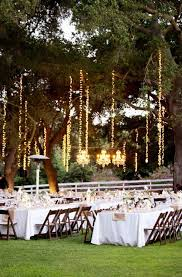 outdoor string lighting in trees amber events saddlerock ranch picotte weddings lights