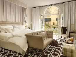 awesome bedroom bench tufted cushion light brown cushion white bedding long grey curtains black and white carpet patterned