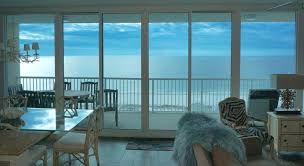 a wall of windows provides a panoramic water view