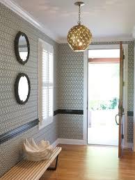 Contemporary medium tone wood floor entryway idea in Raleigh with  multicolored walls