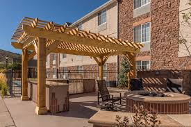 outdoor room fire pit outdoor kitchen pergola stained concrete patio