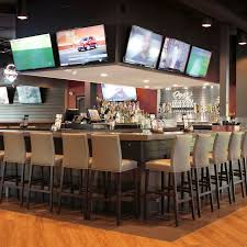 image of oggi s bar with seats and televisions