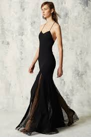 Emily Ratajkowski shows cleavage in flesh toned gown at amfAR gala.