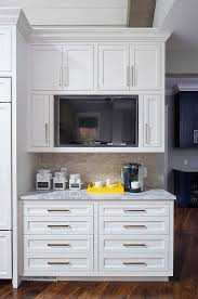 hide tv furniture. cabinets are sherwin williams sw 7004 snowbound love the cabinet style and hidden tv nice coffee station counters vanilla ice granite hide tv furniture