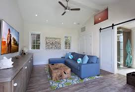 beach house tv room with louvered cabinet