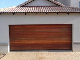 wooden garage door rain deflector fluidelectric