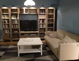 living room with a tv cabinet and bookshelves