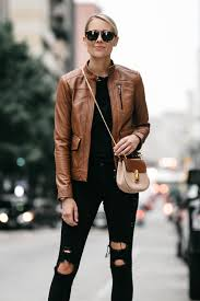 blonde woman wearing tan leather moto jacket black ripped skinny jeans outfit chloe drew handbag fashion