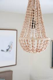 remodelaholic how to make a wood bead chandelier wooden bead chandelier