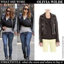 olivia wilde in black leather biker jacket balenciaga blue jeans and hi top sneakers want her