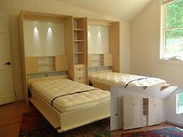 double wall bed with classic face and crown moldings in hand stained birch wood