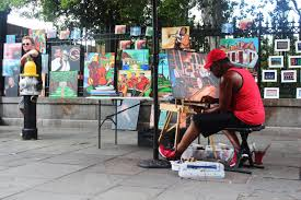 an artist works on a new piece while ing his work at jackson square