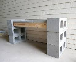 View in gallery Wood, cinder blocks and pavers form a sturdy bench