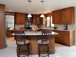 add an island peninsula pantry or additional cabinets refacing uses your existing layout but you can add on as your space allows
