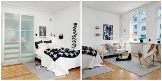 living room with bed:  white living room with black shades
