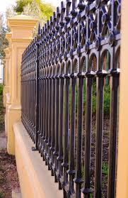 wrought iron fence ideas. Exellent Wrought A Classic Wrought Iron Design Is Incorporated Into This Mixed Material Fence  In Wrought Iron Fence Ideas