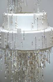 the most fabulous design elements in the wedding was the stunning tiered white wedding cake dripping with swarovski crystals placed on its own dd stage