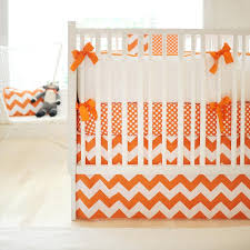 white and orange crib bedding