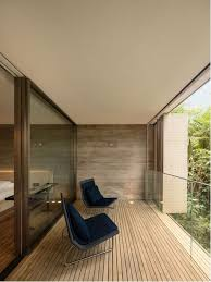 Example of a huge minimalist balcony design in Other with a roof extension