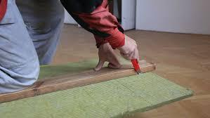 man cutting fiberglass insulation