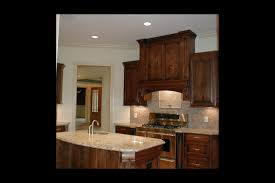 over stove lighting. this kitchen boasts of a potfiller over the stove and lots light lighting e