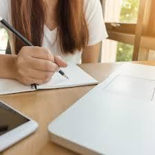 Woman Writing On Paper Free Stock Photo