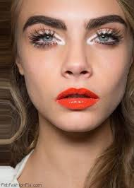loving cara delevingne with bold eyebrows and orange lipstick middot cara delevingne makeup tutorial