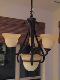 our house came with builder grade chandeliers i the glass domes they look like a cond well let s just say they are a yellowish gold