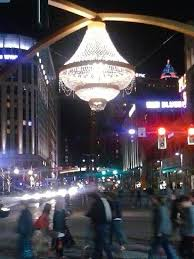 the chandelier lights up the night and the entrance to playhouse square