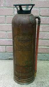 old antique vintage copper brass fire extinguisher