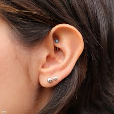 Everything You Need To Know Before Getting A Rook Piercing Her Campus