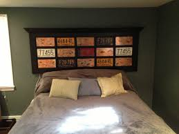 Headboard made from French door. Inserted with copper and license plates.