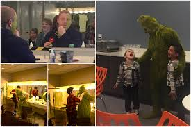reed sigmund putting on makeup and his grinch costume for children theatre co s