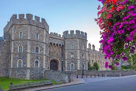 windsor castle in the morning with flowers in hanging baskets windsor berkshire england
