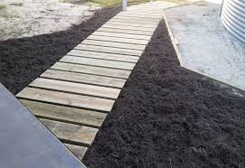 path is made from pressure treated wood to resist rot step by step tutorial with lots of photos to help you build a garden path you can use for years
