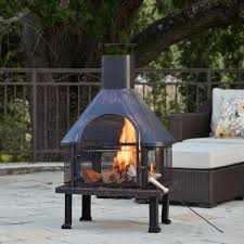this taller style fire pit offers a door and chimney for ease of use