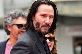 Keanu Reeves Poses For Photos Without Touching Women